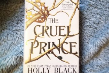 The Cruel Prince by Holly Black on top of a fuzzy blue blanket