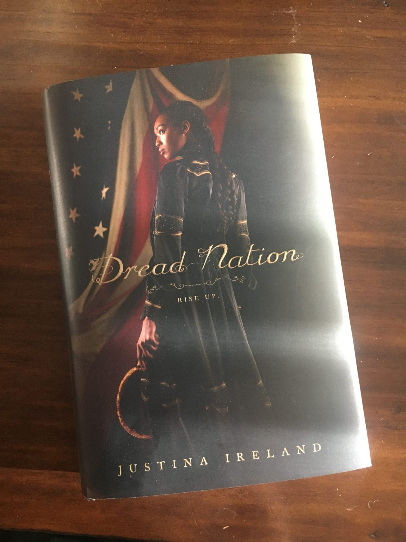 Hardcover of Justina Ireland's novel Dread Nation on a wooden desk