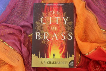 Novel CITY OF BRASS on multicolored fabric