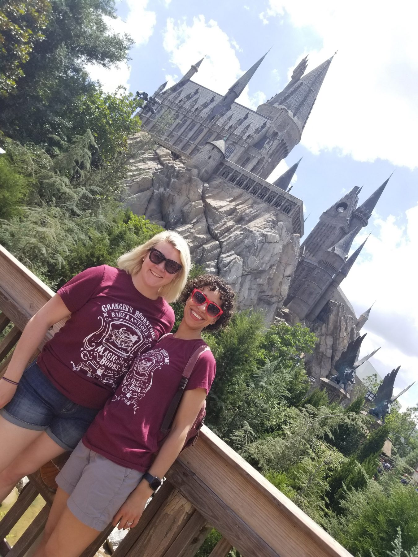 J & K in matching t-shirts in front of Hogwarts Castle