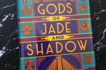 Book Gods of Jade and Shadow on a black marble background
