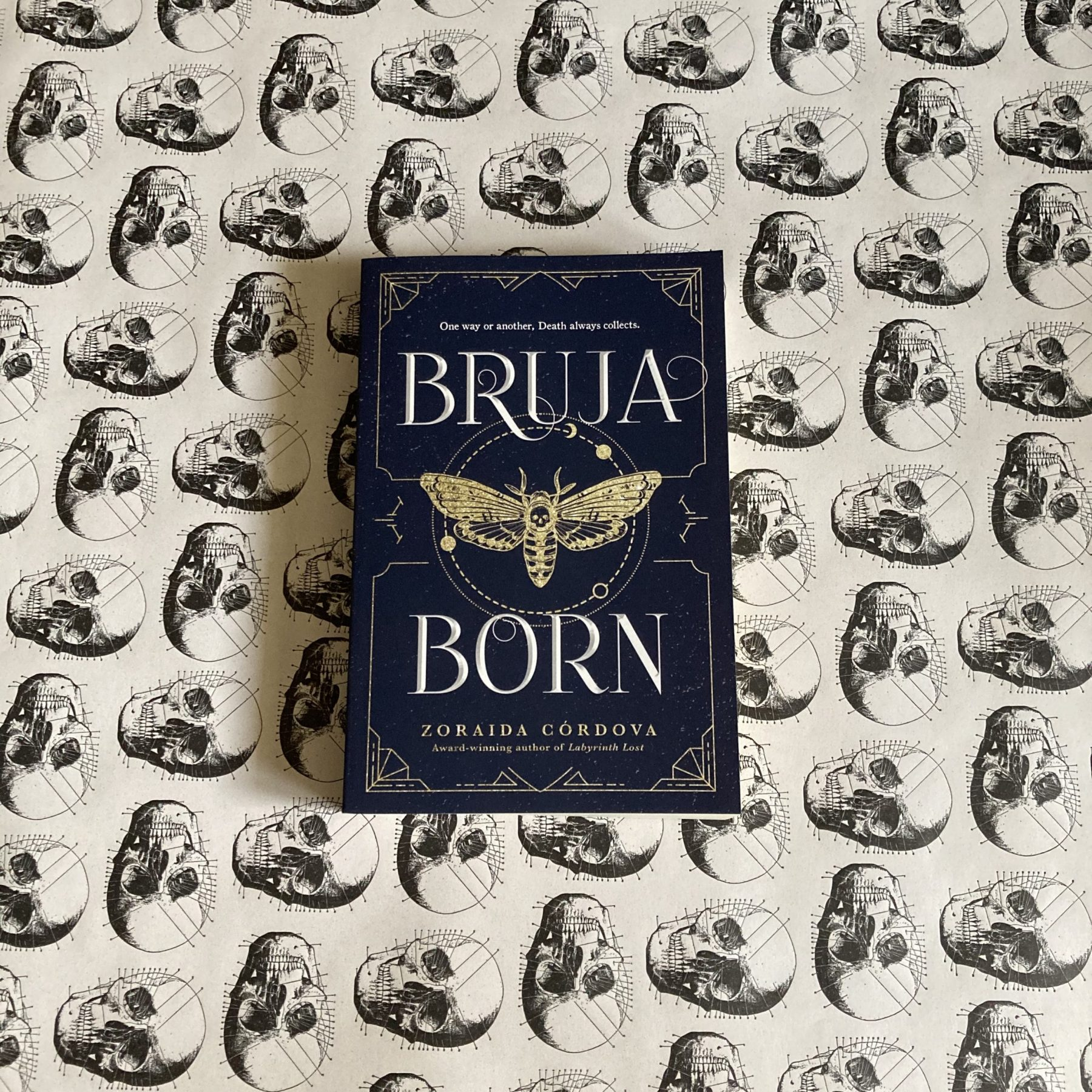 book Bruja Born on a white background with skulls