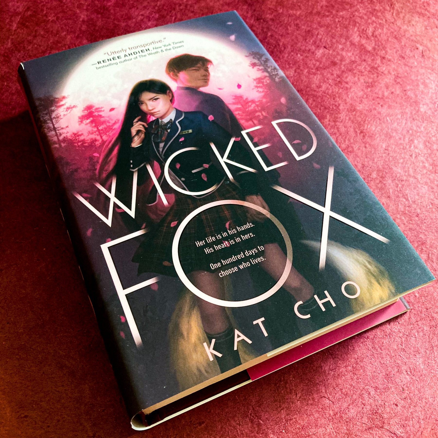 Hardcover of Wicked Fox on a maroon background