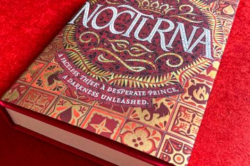 Hardcover version of Nocturna sit on a bright red background