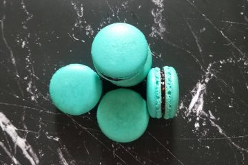 blue macarons on a black marble background