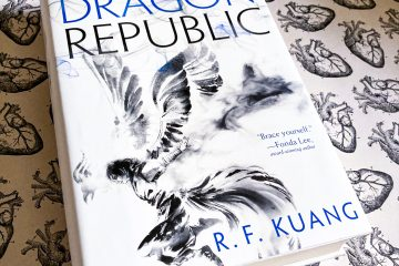 Hardcover of The Dragon Republic lays on top of decorative paper with anatomical heart drawings